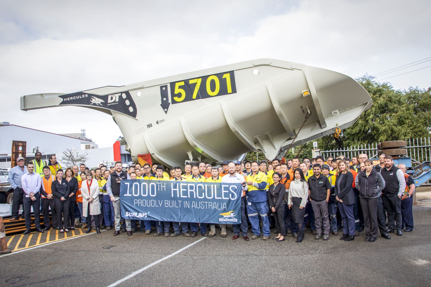 Schlam Employees standing in front of the 1000th Hercules Dump Body