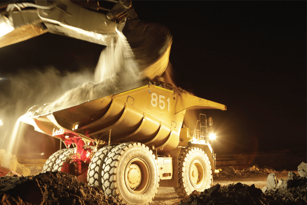 Mining dump truck being filled with with sand