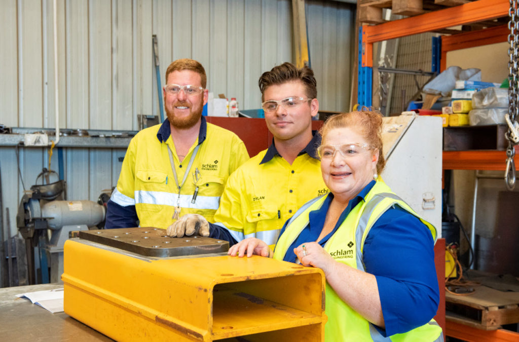 3 Schlam employees working in a warehouse