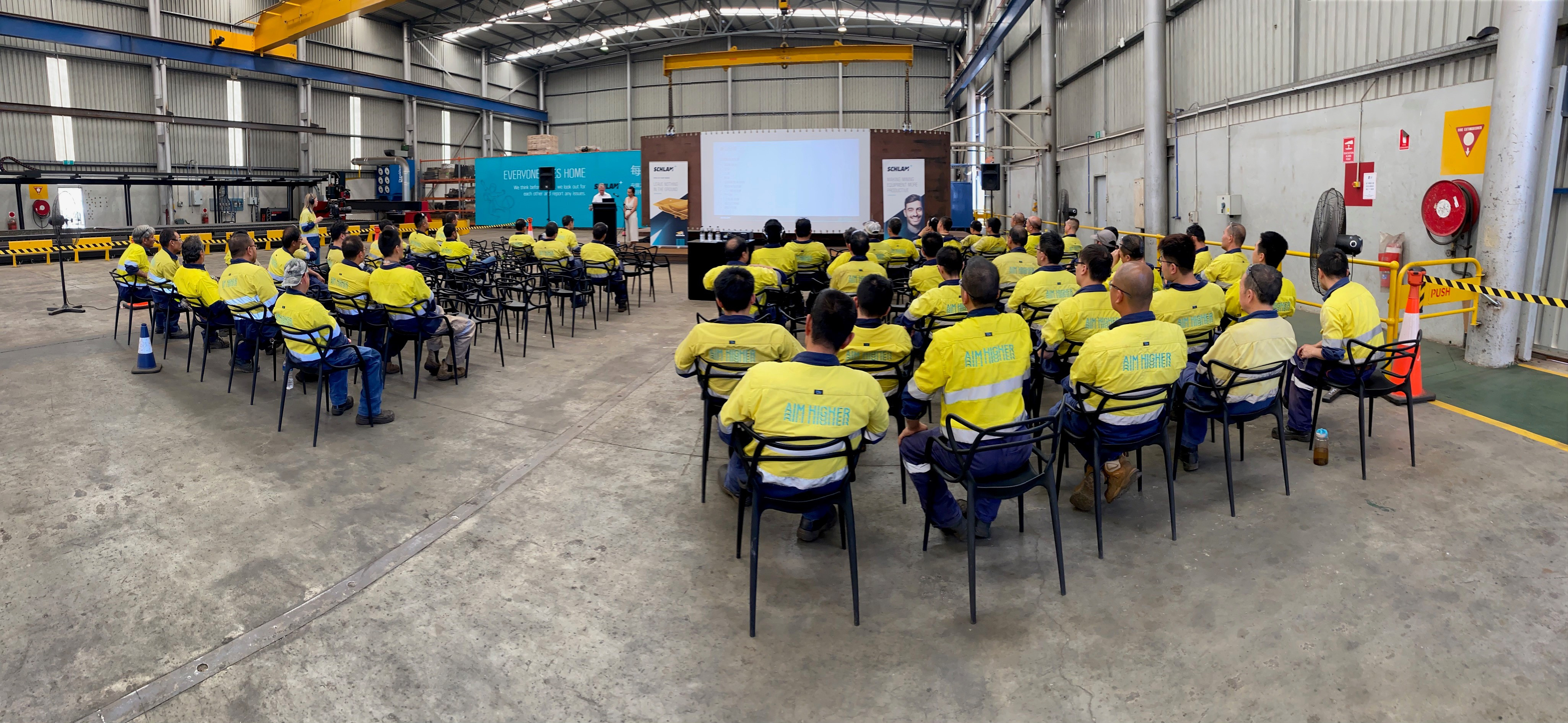 Schlam Townhall with employees seated